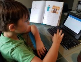 Typing up his Minecraft story. Sebastian's 1st blog post!