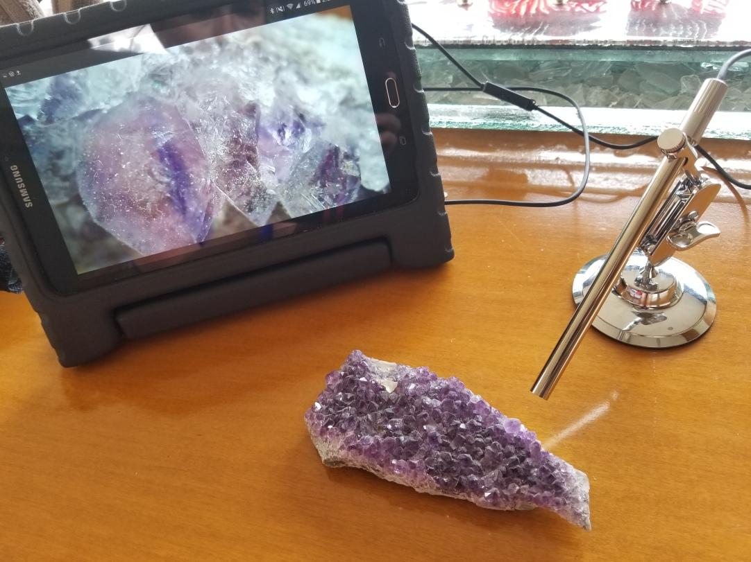 Using the new USB digital microscope to examine stones.